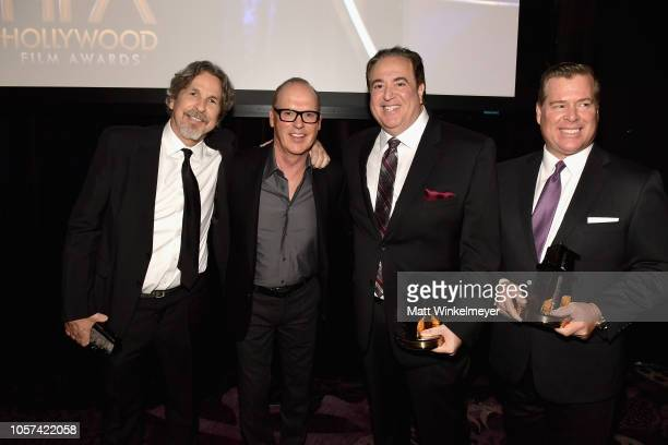 Michael Keaton poses with Peter Farrelly Nick Vallelonga and Brian Hayes Currie recipients of the Hollywood Screenwriter Award for 'Green Book'...