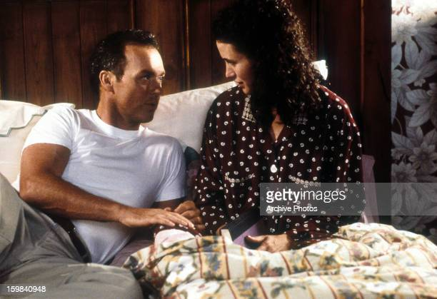 Michael Keaton sits in bed with Andie MacDowell in a scene from the film 'Multiplicity' 1996