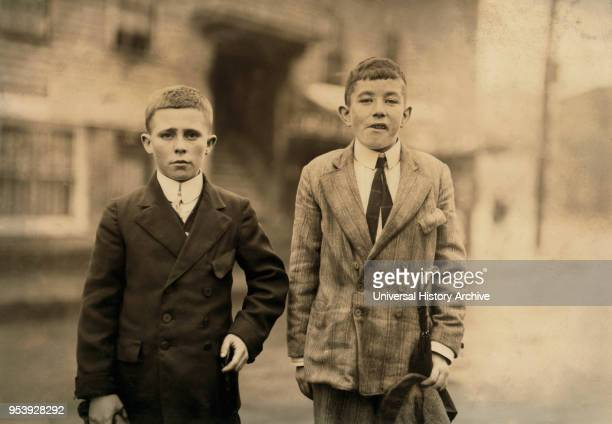 Michael Keefe Cornelius Hurley 13 or 14 years old Young Mill Workers in No 1 Mill Room Merrimac Mill Lowell Massachusetts USA Lewis Hine for National...