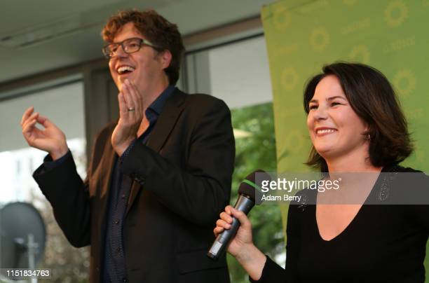Michael Kellner, secretary general of the German Green Party , and Annalena Baerbock, head of the German Green party, speak to supporters after exit...