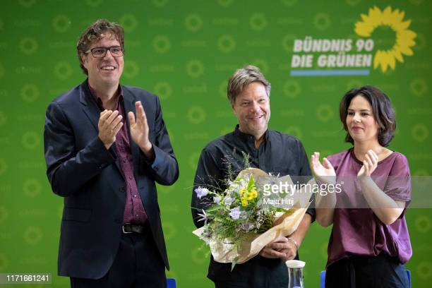 Michael Kellner secretary general of the German Green Party and German Greens Party leaders Robert Habeck and Annalena Baerbock smile prior a party...