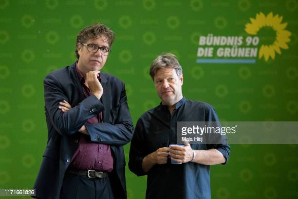 Michael Kellner, secretary general of the German Green Party and German Greens Party leader Robert Habeck wait prior a party board meeting the day...