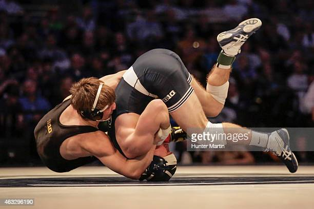 Michael Kelly of the Iowa Hawkeyes and Luke Frey of the Penn State Nittany Lions during their match on February 8 2015 at the Bryce Jordan Center on...