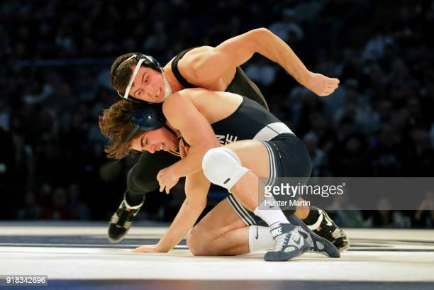 Michael Kemerer of the Iowa Hawkeyes wrestles Bo Pipher of the Penn State Nittany Lions on February 10 2018 at the Bryce Jordan Center on the campus...