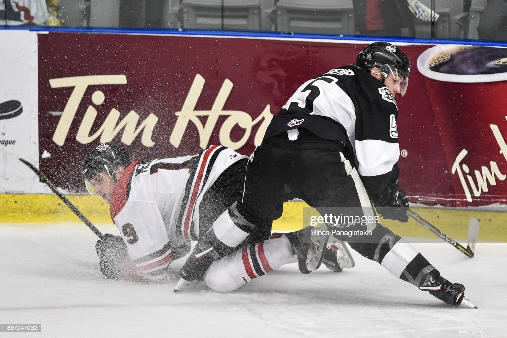 Michael Kemp #5 of the Blainville-Boisbriand Armada takes down Dawson Mercer #19 of the Drummondville Voltigeurs during the QMJHL game at Centre d'Excellence Sports Rousseau on October 27, 2017 in Boisbriand, Quebec, Canada. The Blainville-Boisbriand Armada defeated the Drummondville Voltigeurs 2-0.
