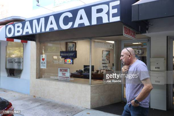 Michael Khoury stands outside of his Leading Insurance Agency, which offers plans under the Affordable Care Act on January 28, 2021 in Miami,...