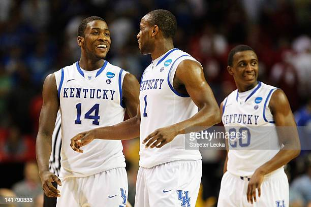 Michael KiddGilchrist Darius Miller and Doron Lamb of the Kentucky Wildcats react during their 102 to 90 win over the Indiana Hoosiers during the...