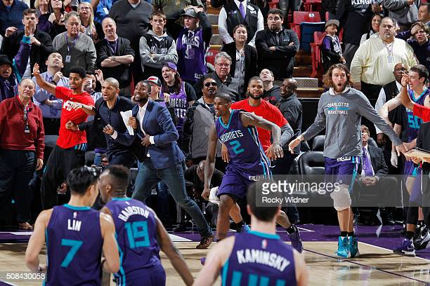 Michael KiddGilchrist Marvin Williams and Spencer Hawes of the Charlotte Hornets cheer on their teammates against the Sacramento Kings on January 25...