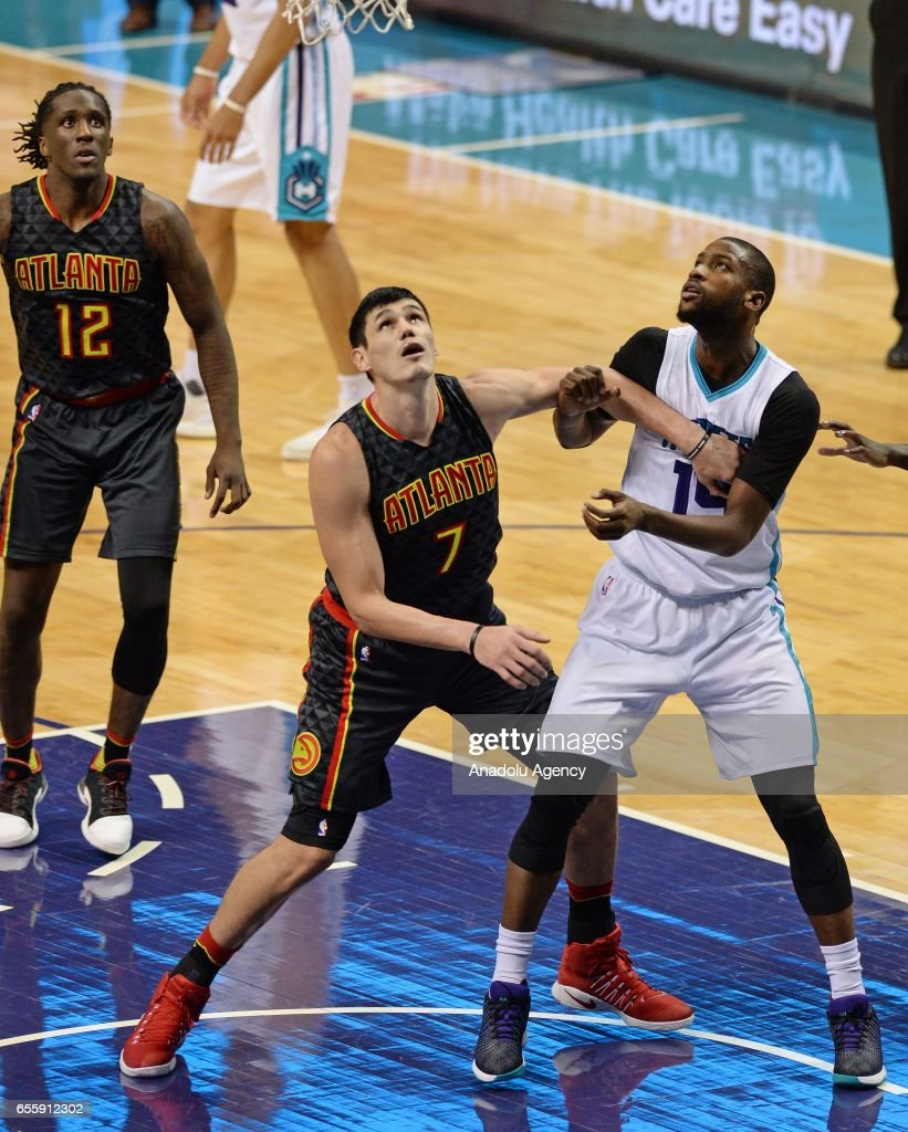 Michael Kidd-Gilchrist (R) of Charlotte Hornets in action against Ersan Ilyasova (7) of Atlanta Hawks during the NBA match between Atlanta Hawks vs Charlotte Hornets at the Spectrum arena in Charlotte, United States on March 20, 2017.