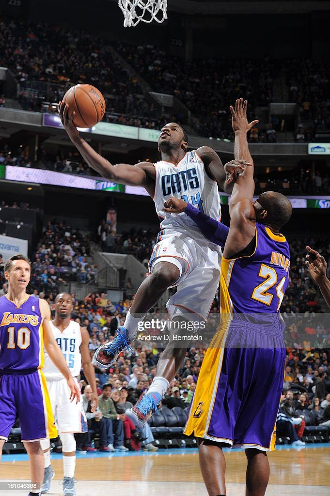 Michael Kidd-Gilchrist #14 of the Charlotte Bobcats goes in for a layup against Kobe Bryant #24 of the Los Angeles Lakers on February 8, 2013 at the Time Warner Cable Arena in Charlotte, North Carolina.