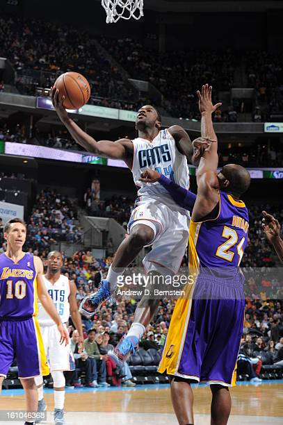 Michael KiddGilchrist of the Charlotte Bobcats goes in for a layup against Kobe Bryant of the Los Angeles Lakers on February 8 2013 at the Time...