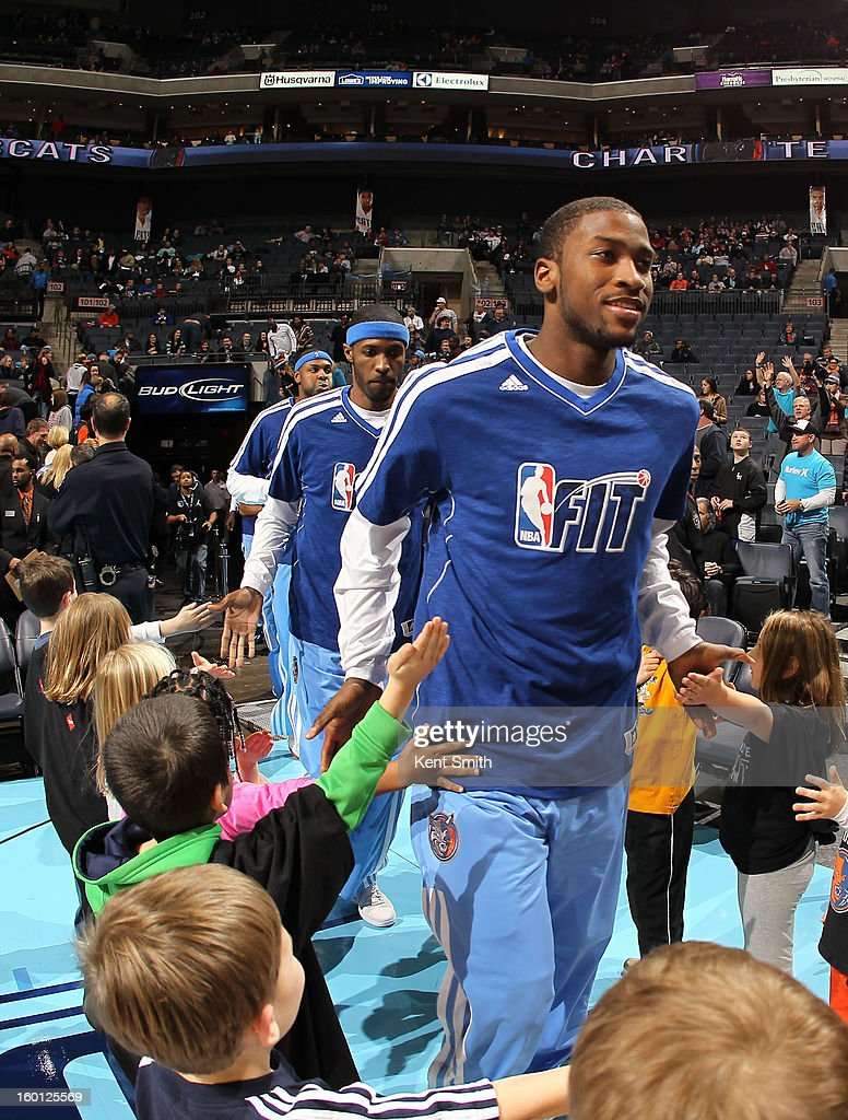 Michael Kidd-Gilchrist #14 of the Charlotte Bobcats greets young fans before the game against the Minnesota Timberwolves at the Time Warner Cable Arena on January 26, 2013 in Charlotte, North Carolina.