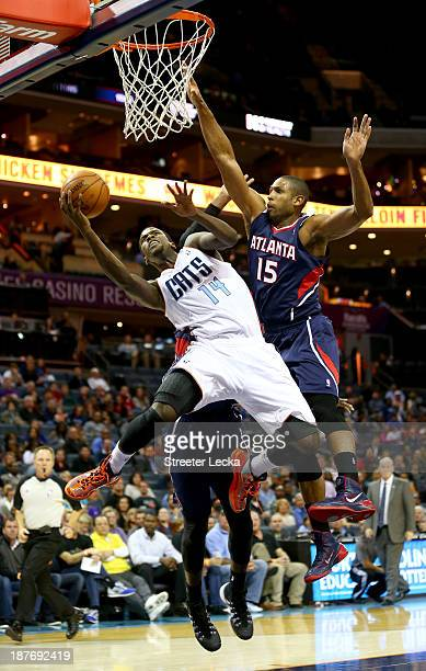 Michael KiddGilchrist of the Charlotte Bobcats is fouled by Al Horford of the Atlanta Hawks during their game at Time Warner Cable Arena on November...