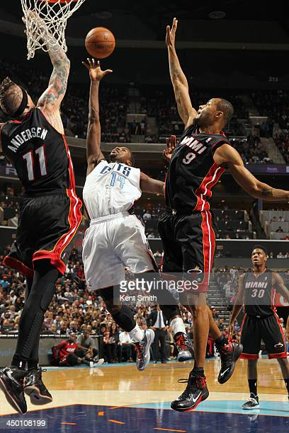 Michael KiddGilchrist of the Charlotte Bobcats shoots against Chris Andersen and Rashard Lewis of the Miami Heat during the game at the Time Warner...