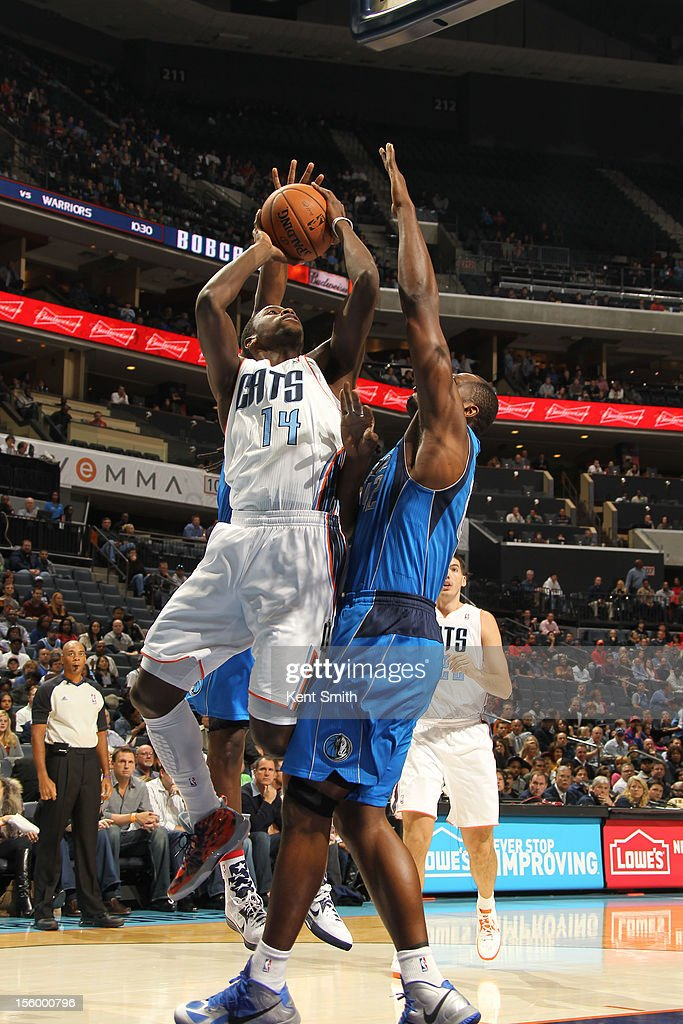 Michael Kidd-Gilchrist #14 of the Charlotte Bobcats shoots against Elton Brand #42 of the Dallas Mavericks at the Time Warner Cable Arena on November 10, 2012 in Charlotte, North Carolina.