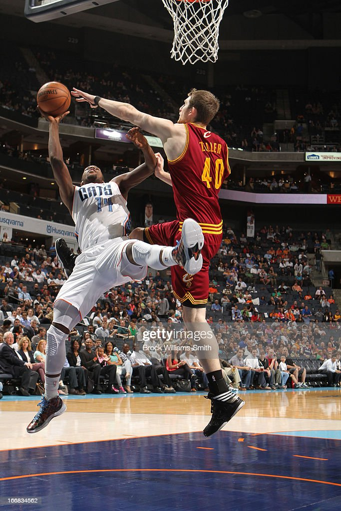 Michael Kidd-Gilchrist #44 of the Charlotte Bobcats shoots against Tyler Zeller #40 of the Cleveland Cavaliers at the Time Warner Cable Arena on April 17, 2013 in Charlotte, North Carolina.