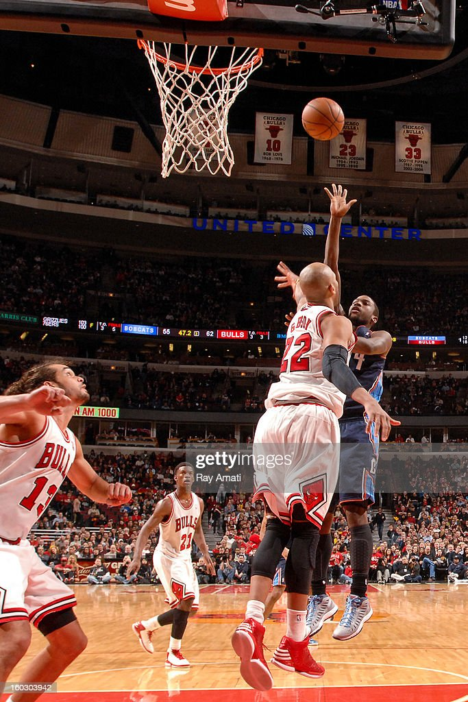 Michael Kidd-Gilchrist #14 of the Charlotte Bobcats shoots in the lane against Taj Gibson #22 of the Chicago Bulls on January 28, 2013 at the United Center in Chicago, Illinois.