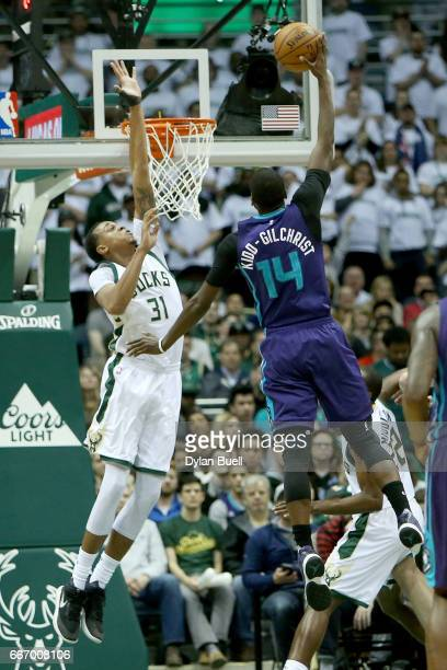 Michael KiddGilchrist of the Charlotte Hornets attempts a shot over John Henson of the Milwaukee Bucks in the second quarter at BMO Harris Bradley...