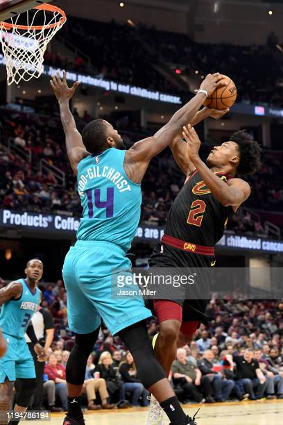 Michael KiddGilchrist of the Charlotte Hornets blocks Collin Sexton of the Cleveland Cavaliers during the second half at Rocket Mortgage Fieldhouse...