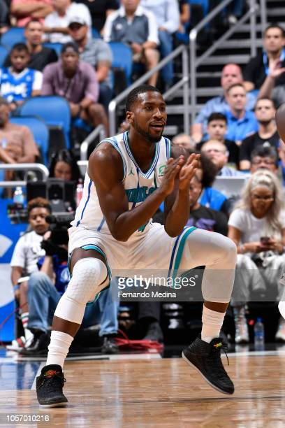 Michael KiddGilchrist of the Charlotte Hornets defends against the Orlando Magic during a game on October 19 2018 at Amway Center in Orlando Florida...
