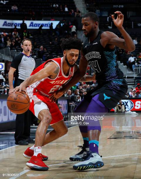 Michael KiddGilchrist of the Charlotte Hornets defends against Tyler Dorsey of the Atlanta Hawks at Philips Arena on January 31 2018 in Atlanta...