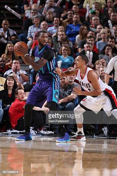 Michael KiddGilchrist of the Charlotte Hornets defends the ball against the CJ McCollum of the Portland Trail Blazers during the game on January 29...