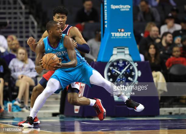 Michael KiddGilchrist of the Charlotte Hornets drives to the basket against Rui Hachimura of the Washington Wizards during their game at Spectrum...