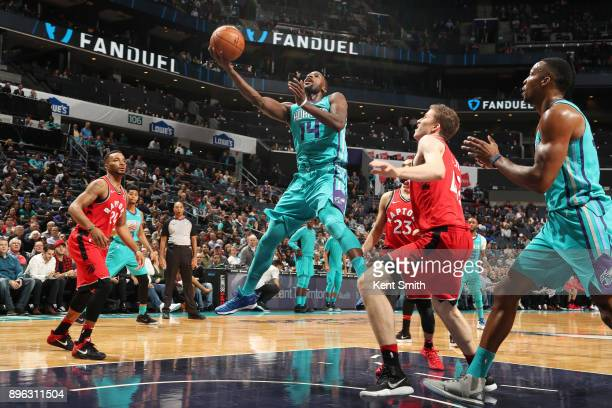 Michael KiddGilchrist of the Charlotte Hornets drives to the basket against the Toronto Raptors on December 20 2017 at Spectrum Center in Charlotte...