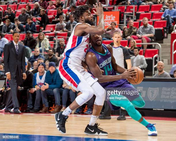 Michael KiddGilchrist of the Charlotte Hornets drives to the basket on Eric Moreland of the Detroit Pistons during the NBA game at Little Caesars...