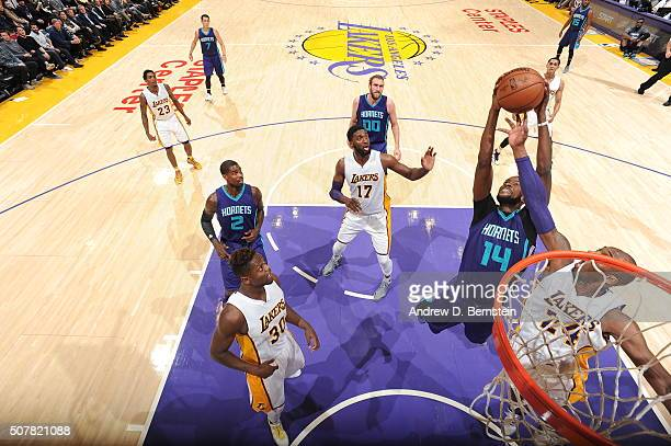 Michael KiddGilchrist of the Charlotte Hornets grabs the rebound against Kobe Bryant of the Los Angeles Lakers on January 31 2016 at STAPLES Center...