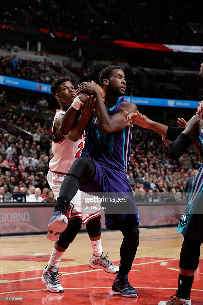 Michael Kidd-Gilchrist #14 of the Charlotte Hornets grabs the rebound against the Chicago Bulls on February 25, 2015 at the United Center in Chicago, Illinois.