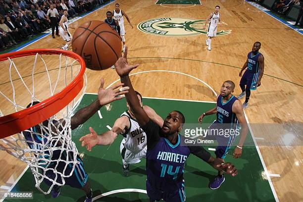 Michael KiddGilchrist of the Charlotte Hornets grabs the rebound against the Milwaukee Bucks on October 26 2016 at the BMO Harris Bradley Center in...