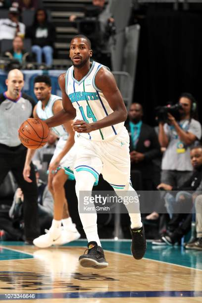 Michael KiddGilchrist of the Charlotte Hornets handles the ball against the New York Knicks on December 14 2018 at Spectrum Center in Charlotte North...