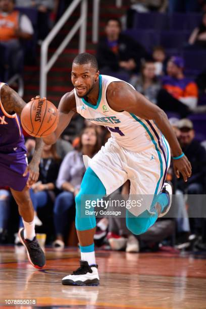 Michael KiddGilchrist of the Charlotte Hornets handles the ball against the Phoenix Suns on January 6 2019 at Talking Stick Resort Arena in Phoenix...