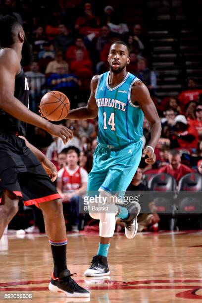Michael KiddGilchrist of the Charlotte Hornets handles the ball against the Houston Rockets on December 13 2017 at the Toyota Center in Houston Texas...