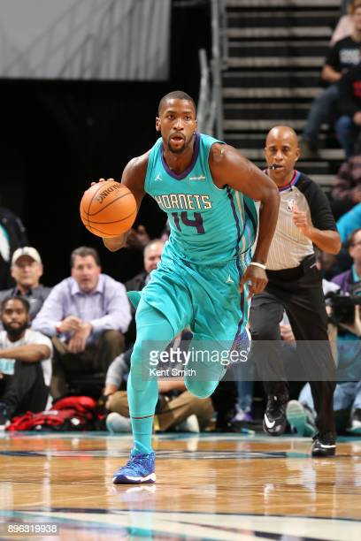 Michael KiddGilchrist of the Charlotte Hornets handles the ball against the Toronto Raptors on December 20 2017 at Spectrum Center in Charlotte North...