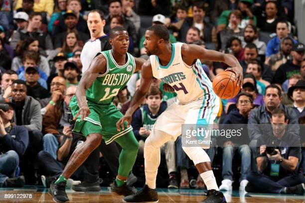 Michael KiddGilchrist of the Charlotte Hornets handles the ball during the game against the Boston Celtics on December 27 2017 at Spectrum Center in...
