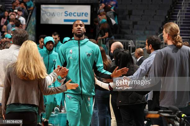Michael KiddGilchrist of the Charlotte Hornets high fives the fans before the game against the Sacramento Kings on December 17 2019 at Spectrum...