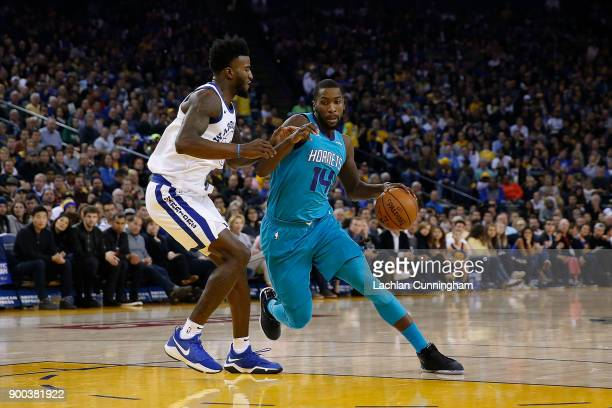 Michael KiddGilchrist of the Charlotte Hornets is guarded by Jordan Bell of the Golden State Warriors at ORACLE Arena on December 29 2017 in Oakland...