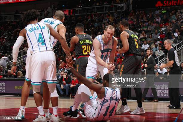 Michael KiddGilchrist of the Charlotte Hornets is helped up by his teammates during the game against the Atlanta Hawks on February 9 2019 at State...