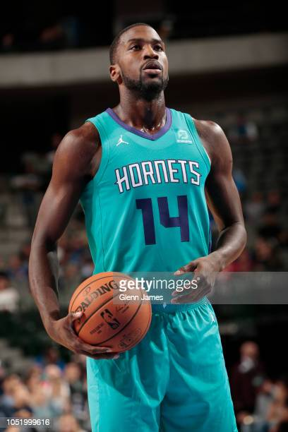 Michael KiddGilchrist of the Charlotte Hornets prepares to shoot a free throw against the Dallas Mavericks on October 12 2018 at the American...