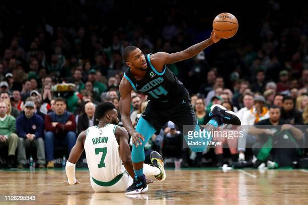 Michael KiddGilchrist of the Charlotte Hornets reaches for a loose ball after falling over Jaylen Brown of the Boston Celtics during the first half...