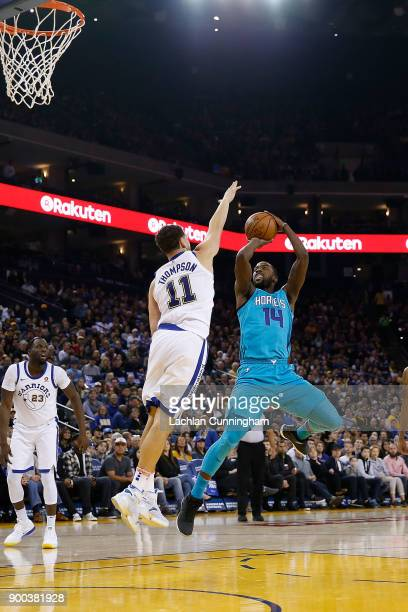 Michael KiddGilchrist of the Charlotte Hornets shoots over Klay Thompson of the Golden State Warriors at ORACLE Arena on December 29 2017 in Oakland...