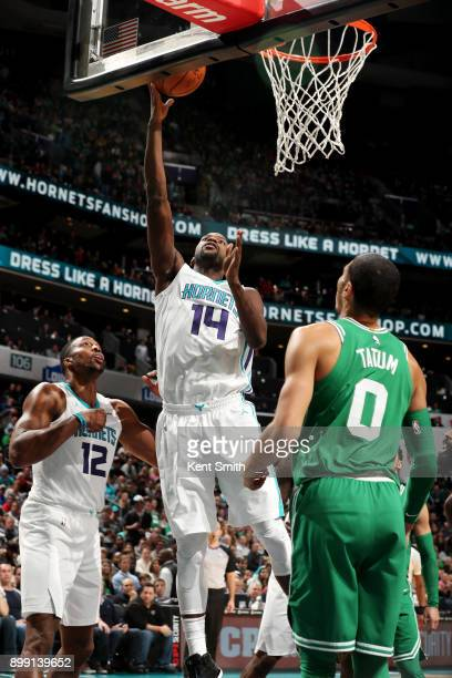 Michael KiddGilchrist of the Charlotte Hornets shoots the ball during the game against the Boston Celtics on December 27 2017 at Spectrum Center in...