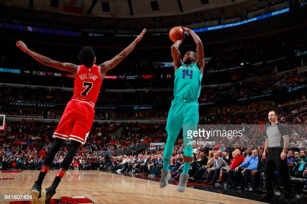 Michael KiddGilchrist of the Charlotte Hornets shoots the ball against the Chicago Bulls on April 3 2018 at the United Center in Chicago Illinois...