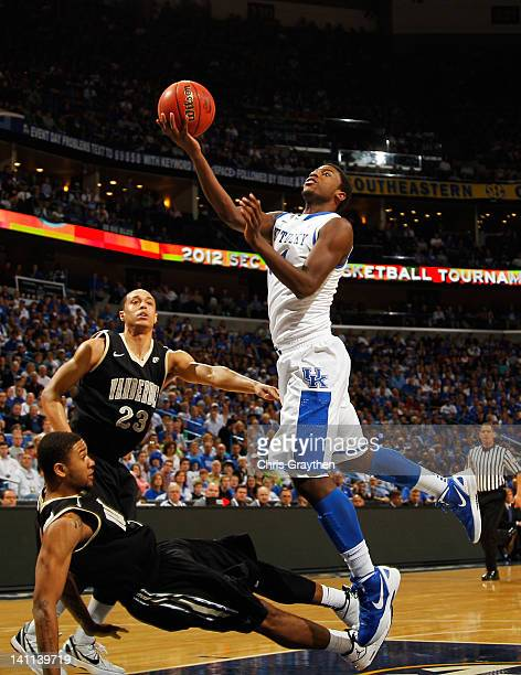 Michael KiddGilchrist of the Kentucky Wildcats goes to the basket over Kedren Johnson of the Vanderbilt Commodores in the first half during the...