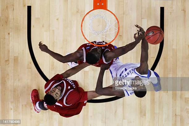 Michael KiddGilchrist of the Kentucky Wildcats goes up against Christian Watford and Victor Oladipo of the Indiana Hoosiers during the 2012 NCAA...