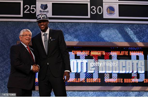 Michael KiddGilchrist of the Kentucky Wildcats greets NBA Commissioner David Stern after he was selected number two overall by the Charlotte Bobcats...