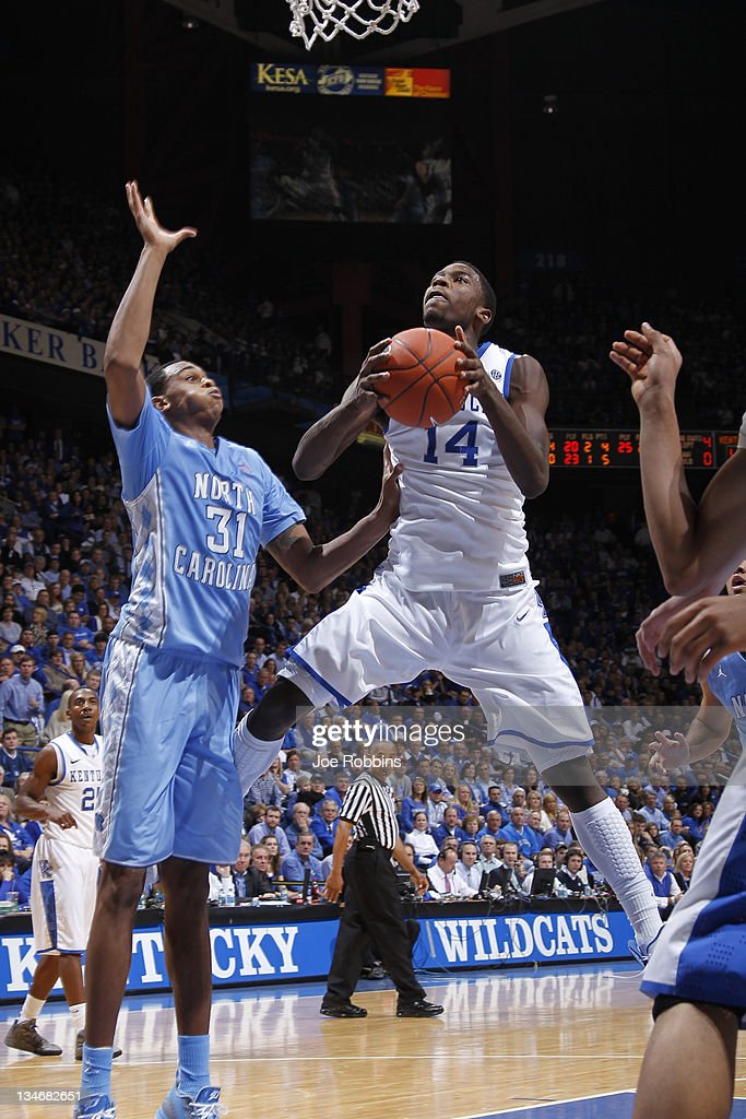Michael Kidd-Gilchrist #14 of the Kentucky Wildcats shoots against John Henson #31 of the North Carolina Tar Heels during their game at Rupp Arena on December 3, 2011 in Lexington, Kentucky. Kentucky won 73-72.