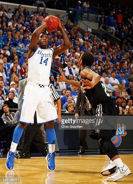 Michael KiddGilchrist of the Kentucky Wildcats shoots over Kedren Johnson of the Vanderbilt Commodores in the first half during the championship game...
